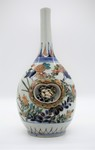 07 Long-necked polychrome vase with carved niches of flowers and hen with eggs
